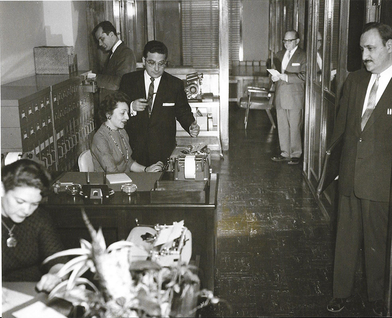 Harry Jacobs and staff in office
